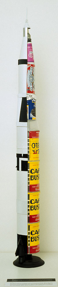 Saturn V Rocket, 2000, displaying various kinds of fuel necessary for artistic endeavor.  Work now missing.